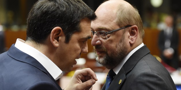 Greek prime minister Alexis Tsipras (L), talks with European parliament president Martin Schulz, before a round table meeting as part on an EU summit at the EU headquarters in Brussels on June 25, 2015.    Talks between eurozone finance ministers broke up without agreeing on a Greek debt deal, with a new meeting due in coming days, Finland's Alexander Stubb said.  AFP PHOTO/ ALAIN JOCARD        (Photo credit should read ALAIN JOCARD/AFP/Getty Images)