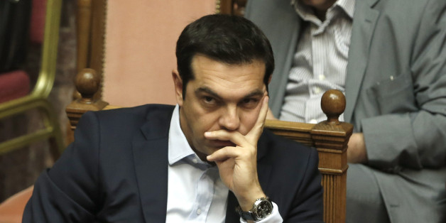 Greece's Prime Minister Alexis Tsipras attends an emergency Parliament session for the government's proposed referendum in Athens, Saturday, June 27, 2015. After five months of fruitless negotiations, relations between Greece and its creditors crumbled further Saturday after Prime Minister Tsipras stunned them by calling for a referendum on the proposed reforms needed to get bailout loans. (AP Photo/Petros Karadjias)