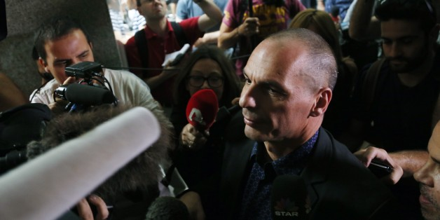 Greece's Finance Minister Yanis Varoufakis surrounded by media as he arrives for a meeting with heads of the Greek banks at the Finance Ministry in Athens, Sunday, June 28, 2015. The European Central Bank refused to increase emergency credit to Greek banks on Sunday, a day after the government threw Greece's bailout negotiations into turmoil by calling a referendum on creditors' financial proposals. (AP Photo/Petros Karadjias)
