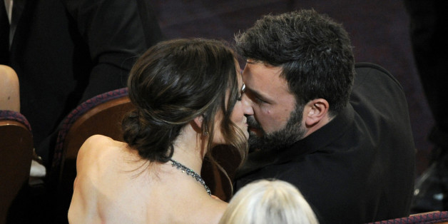"Jennifer Garner, left, kisses director Ben Affleck after ""Argo"" is announced the winner for the award for best picture during the Oscars at the Dolby Theatre on Sunday Feb. 24, 2013, in Los Angeles.  (Photo by Chris Pizzello/Invision/AP)"