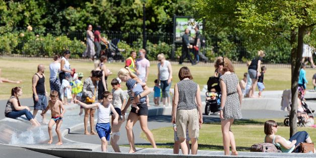 People cool off in part of the Princess Diana Memorial Fountain in Hyde Park, London, as temperatures are set to soar to as high as 35C in Britain - amid fears that the heat could disrupt rail services.