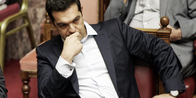 ATHENS, GREECE - JUNE 27:Greek Prime Minister Alexis Tsipras during a parliamentary session in Athens, Greece June 28, 2015 . Greece's fraught bailout talks with its creditors took a dramatic turn early Saturday, with the radical left government announcing a referendum in just over a week on the latest proposed deal . (Photo by Milos Bicanski/Getty Images)