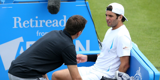 NOTTINGHAM, ENGLAND - JUNE 22:  Malek Jaziri of Tunisia receives treatment in his match against Kyle Edmund of Great Britain on day two of the Aegon Open Nottingham at Nottingham Tennis Centre on June 22, 2015 in Nottingham, England.  (Photo by Jan Kruger/Getty Images for LTA)