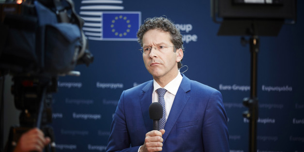 "Dutch Finance Minister and chair of the eurogroup Jeroen Dijsselbloem listens to reporters in the Dutch parliament after a teleconference of the 19 eurozone finance ministers in The Hague, Netherlands on Tuesday, June 30, 2015. Dijsselbloem, says ""it would be crazy to extend"" the Greek bailout beyond its midnight expiration since Greece won't accept the European proposals on the table. He said that a Greek request for a new European aid program would be considered later. (AP Photo/Phil Nijhuis)"