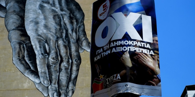 "Hands painted on the wall of a building seen behind a poster for a NO vote in the upcoming referendum, in central Athens, Wednesday, July 1, 2015. European officials and Greek opposition parties have been adamant that a ""No"" vote on Sunday will mean Greece will leave the euro and possibly even the EU. The government rejects the argument as scaremongering, and says dismissing creditor demands will mean the country is in a better negotiating position. (AP Photo/Petros Karadjias)"