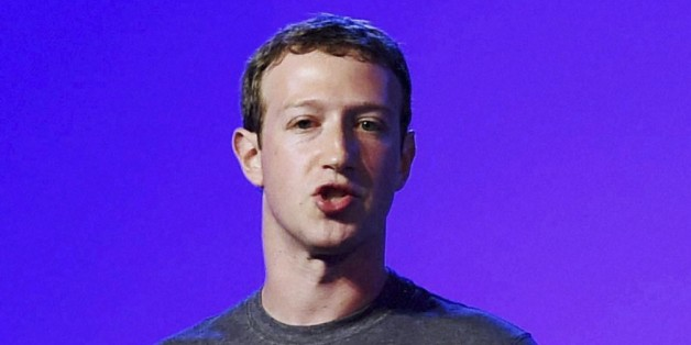 Facebook CEO Mark Zuckerberg addresses the internet.org summit in New Delhi, India, Thursday, Oct.9, 2014. (AP Photo/Press Trust of India) INDIA OUT