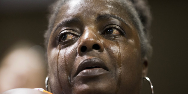"Barbara Lloyd, of Charleston, S.C., cries during the singing of ""We Shall Overcome"" at a memorial service for the victims of the shooting at Emanuel AME Church, Friday, June 19, 2015, in Charleston, S.C. (AP Photo/David Goldman)"