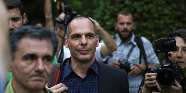 Greece's Finance Minister Yanis Varoufakis, center, and Deputy Foreign Minister for international economic relations, Euclid Tsakalotos, left, arrive for an urgent cabinet meeting at Maximos Mansion in Athens, Sunday, June 28, 2015.  Greek Prime Minister Alexis Tsipras says the Bank of Greece has recommended that banks remain closed and restrictions be imposed on transactions, after the European Central Bank didn't increase the amount of emergency liquidity the lenders can access from the centra