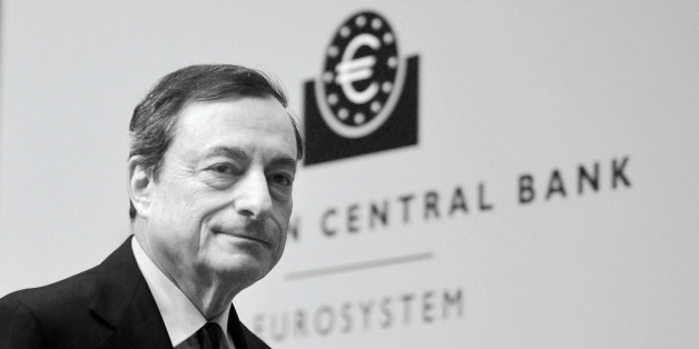 FRANKFURT AM MAIN, GERMANY - DECEMBER 04:  (EDITORS NOTE: This image was processed using digital filters.)  Mario Draghi, President of the European Central Bank pictured during his first press conference following the monthly ECB board meeting in the new ECB headquaters on December 4, 2014 in Frankfurt am Main, Germany.  (Photo by Thomas Lohnes/Getty Images)