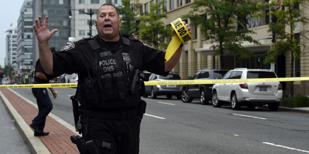 Police tell members of the media to move near the Washington Navy Yard in Washington, Thursday, July 2, 2015. A lockdown was underway Thursday morning across the Washington Navy Yard campus after reports of shots fired, but a senior law enforcement official said those reports had not been confirmed.   (AP Photo/Susan Walsh)