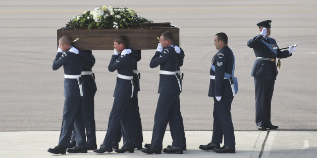 Pallbearers carry a coffin from a British RAF C-17 plane, confirmed as carrying the body of Adrian Evans, as the bodies of eight British nationals killed Friday in the Tunisia beach terror attack at RAF Brize Norton, England, Wednesday July 1, 2015. At least 27 Britons are confirmed among the 38 people shot dead when a Tunisian student opened fire on a beach in the North African nation's central resort of Sousse. (Joe Giddens / Pool photo via AP)