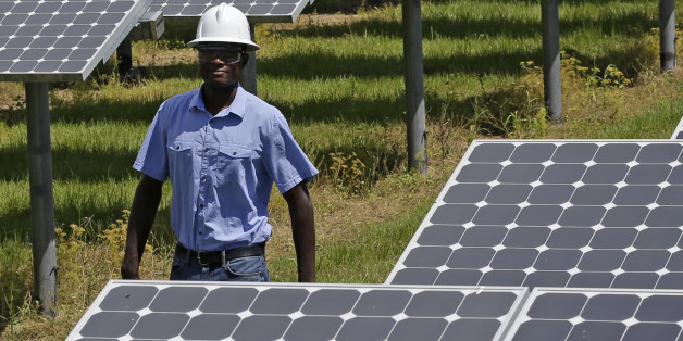 In this Wednesday, May 13, 2015 photo, Henry Plange, a power generation engineer, walks beside some of the more than 37,000 solar panels at the Space Coast Next Generation Solar Center, in Merritt Island, Fla. Industry experts rank Florida third in the nation in rooftop solar energy potential but 13th in the amount of solar energy generated. (AP Photo/John Raoux)