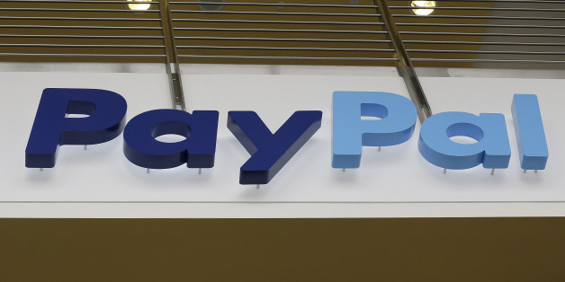 This March 10, 2015 photo shows a PayPal sign inside the main entrance to an office building in San Jose, Calif. (AP Photo/Jeff Chiu)