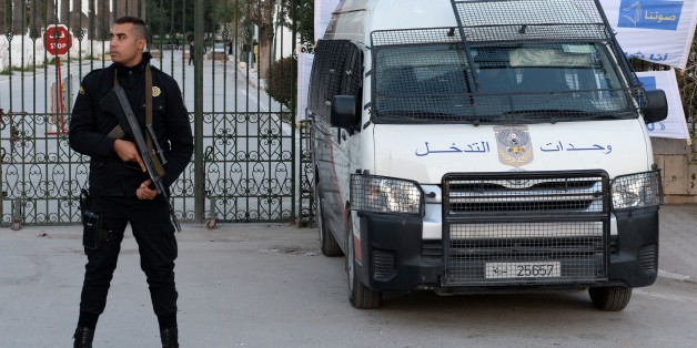 A Tunisian policeman stands guard in front of Tunisia's Bardo National Museum on March 23, 2015 in Tunis, on the eve of its reopening, six days after it witnessed a massacre of foreign tourists. AFP PHOTO / FADEL SENNA        (Photo credit should read FADEL SENNA/AFP/Getty Images)