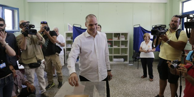 Greece's Finance Minister Yanis Varoufakis cast his vote at a polling station in Athens, Sunday, July 5, 2015. Greeks were voting Sunday in a bailout referendum that will decide the country's future, with opinion polls showing people evenly split on whether to accept creditors' proposals for more austerity in exchange for rescue loans or defiantly reject the deal. (AP Photo/Petr David Josek)