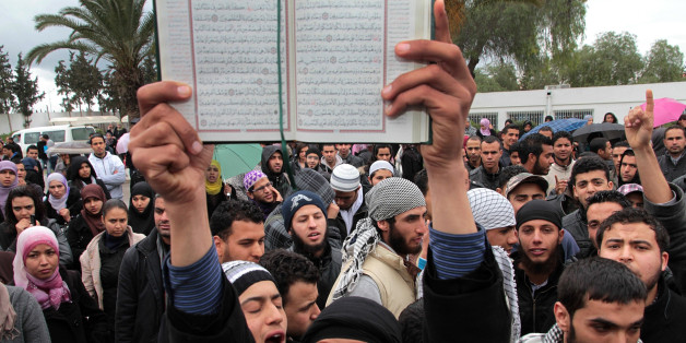 In this Wednesday March 7, 2012 photo an ultraconservative Muslim demonstrates with a Quran at the Manouba university in Tunis after scuffles erupted between Salafists students and members of a leftist students union. In the birthplace of the Arab Spring, the transition from dictatorship to democracy has been mostly smoother than in neighboring countries, with no power hungry military or armed militias to stifle the process. But as a moderate Islamist party rules with the help of secular forces, an unexpected threat has emerged: the increasing boldness of ultraconservative Muslims known loosely as Salafis, who want to turn this North African country of 10 million into a strict Islamic state. (AP Photo/Amine Landoulsi, File)