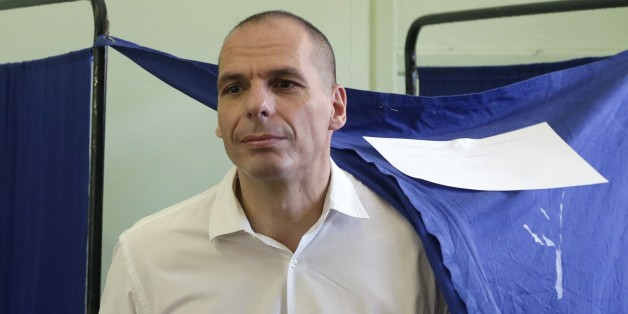 Greece's Finance Minister Yanis Varoufakis casts his vote at a polling station in Athens, Sunday, July 5, 2015. Greeks were voting Sunday in a bailout referendum that will decide the country's future, with opinion polls showing people evenly split on whether to accept creditors' proposals for more austerity in exchange for rescue loans or defiantly reject the deal. (AP Photo/Petr David Josek)