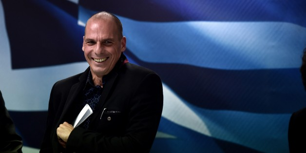 Greece's new Finance minister Yanis Varoufakis smiles after a ministry hand-over ceremony in Athens on January 28, 2015. Varoufakis said today he wants to see a pan-European deal to encourage growth. The new anti-austerity Syriza-led government wants 'a pan-European +New Deal+ that will lead Europe to a reboot', Varoufakis told journalist. AFP PHOTO / ARIS MESSINIS        (Photo credit should read ARIS MESSINIS/AFP/Getty Images)