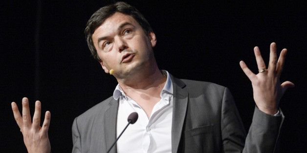 FILE - In this June 30, 2014 file photo, French economist Thomas Piketty speaks during his seminar at the Almedalen political week in Visby on the island of Gotland, in Sweden. Novelist Marilynne Robinson, economist Piketty and cartoonist Roz Chast are among the finalists for National Book Critics Circle prizes. The 30 nominees for six competitive categories were announced Monday, Jan. 19, 2015.  (AP Photo/Janerik Henriksson, File) SWEDEN OUT
