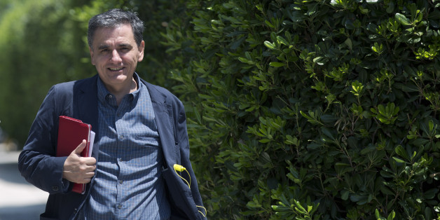 Greece's Deputy Foreign Minister for international economic relations, Euclid Tsakalotos, arrives at the Prime minister's office for an emergency meeting, in Athens, Monday, June 15, 2015. Tsipras held an meeting with the team of Greek bailout negotiators, and said the talks had stalled on demands by the creditors — the other eurozone states and the IMF — for a new round of pension cuts, which his government rejected.(AP Photo/Petros Giannakouris)