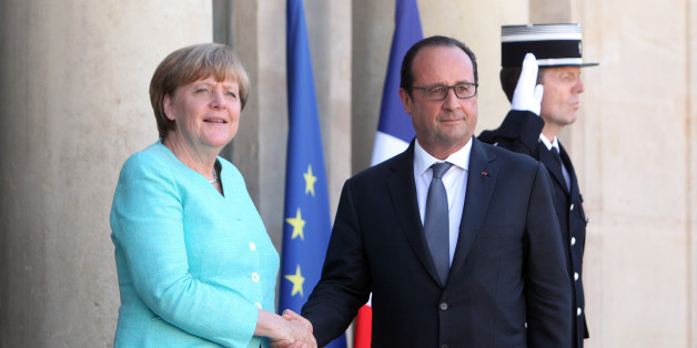 France's President Francois Hollande, right, and German chancellor Angela Merkel shake hands prior to a meeting, at the Elysee Palace, in Paris, France, Monday, July 6, 2015. German Chancellor Angela Merkel has arrived at the Elysee Palace for talks with French President Francois Hollande about the Greek crisis. The two are expected to issue a joint statement that's likely to reflect the line to be taken at the summit. France has appeared more conciliatory than Germany toward Greece over the pas