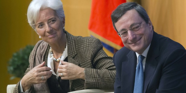 "Managing Director of the International Monetary Fund Christine Lagarde, left, and European Central Bank President Mario Draghi, right, smile during a panel on""growth and integration with solidarity, what kind of strategy for Europe?""at the finance ministry in Paris, Friday, Nov. 30, 2012. (AP Photo/Michel Euler)"