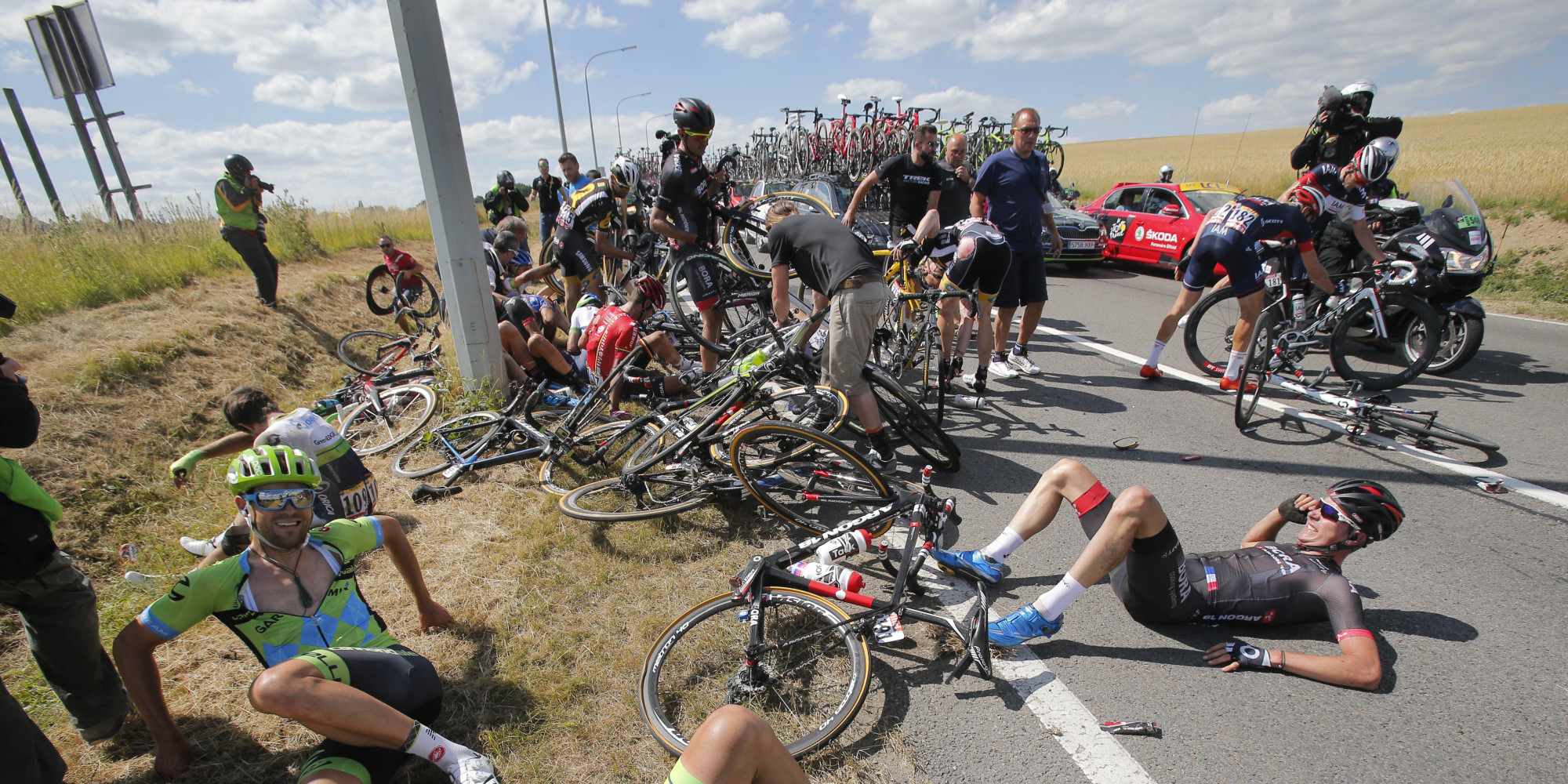 Horrible Tour De France Crash Brings Down 20 Riders, Briefly Stops ...