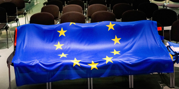 BERLIN, GERMANY - MARCH 23:  The flag of the European Union lies on chairs after German Chancellor Angela Merkel and Greek Prime Minister Alexis Tsipras spoke to the media upon his arrival for talks at the Chancellery on March 23, 2015 in Berlin, Germany. The two leaders are meeting as relations between the Tsipras government and Germany have soured amidst contrary views between the two countries on how Greece can best work itself out of its current economic morass.  (Photo by Carsten Koall/Gett
