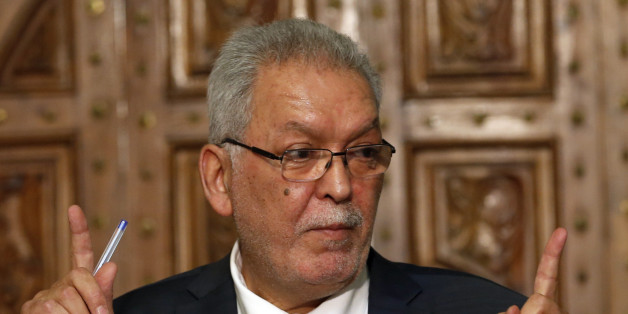 Kamel Jendoubi, Minister to the Prime Minister in charge of Relations with Constitutional Bodies and the Civil Society, gestures during a press conference in Tunis, Tunisia, Thursday, July 2, 2015. The Islamic State group claimed responsibility for the attack, in which a Tunisian student opened fire on a beach in the resort of Sousse. The attacker was later killed by police. (AP Photo/Darko Vojinovic)