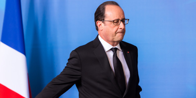 French President Francois Hollande walks off the podium after a media conference at an EU summit in Brussels on Friday, June 26, 2015. President Francois Hollande, speaking in Brussels, said one person was killed and two injured in an attack at a gas factory in Saint-Quentin-Fallavier, southeast of Lyon, France. (AP Photo/Geert Vanden Wijngaert)