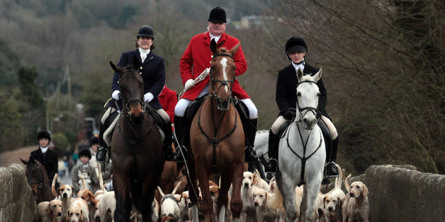 Jonathon Seed, Joint Master and Huntsman with the Avon Vale Hunt, leads the hounds and fellow riders for their traditional Boxing Day hunt in Lacock, England.