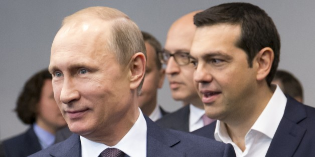 Russian President Vladimir Putin, foreground, and Greek Prime Minister, behind him, Alexis Tsipras arrive for their talks at the St. Petersburg International Investment Forum in St.Petersburg, Russia, Friday, June 19, 2015.Russia is willing to consider giving financial aid to Greece, President Vladimir Putin's spokesman said Friday ahead of talks between the leaders of the two countries. (AP Photo/Alexander Zemlianichenko)