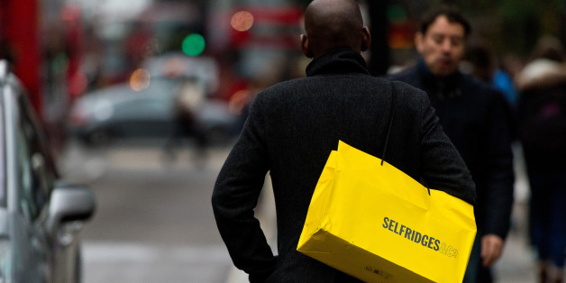 LONDON, ENGLAND - DECEMBER 26:  Shopper carries a Selfridges bag on Oxford Street during the annual boxing day sales on December 26, 2014 in London, England.  (Photo by Ben A. Pruchnie/Getty Images)
