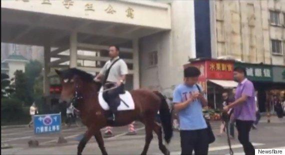 man rides horse