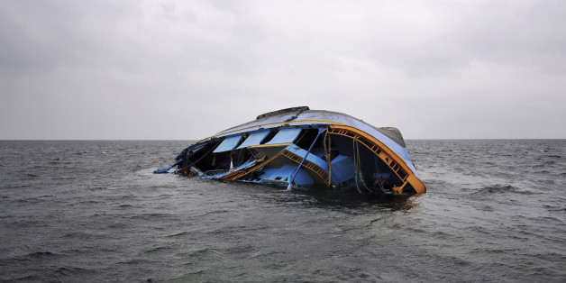 A capsized ship that originated from Libya and which according to the United Nations refugee agency was transporting an estimated 850 refugees, lies on a sandbar 35 kilometers (22 miles) north of the Tunisian islands of Kerkennah, Saturday, June 4, 2011. The Geneva-based agency said Friday at least 578 of the estimated 850 people on board, mostly from West Africa, Pakistan and Bangladesh, survived the Wednesday sinking, making it one of the worst and deadliest incidents in the Mediterranean so far this year. (AP Photo/Lindsay Mackenzie)