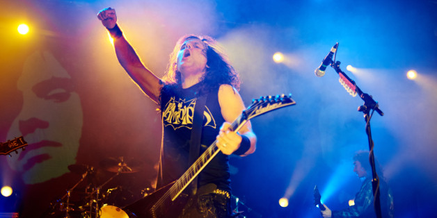 MANCHESTER, UNITED KINGDOM - DECEMBER 19: Mille Petrozza of Kreator performs on stage at Manchester Academy on December 19, 2014 in Manchester, United Kingdom. (Photo by Gary Wolstenholme/Redferns via Getty Images)