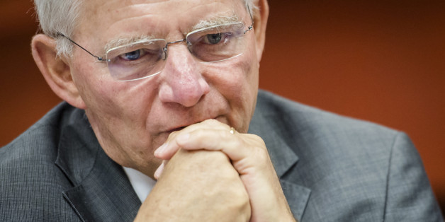 German Finance Minister Wolfgang Schauble arrives for a EU finance ministers meeting at the European Council building in Brussels, Tuesday, July 8, 2014. (AP Photo/Geert Vanden Wijngaert)