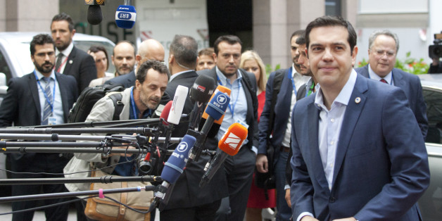 Greek Prime Minister Alexis Tsipras arrives for a meeting of eurozone heads of state at the EU Council building in Brussels on Sunday, July 12, 2015. Greece has another chance Sunday to convince skeptical European creditors that it can be trusted to enact wide-ranging economic reforms which would safeguard its future in the common euro currency. (AP Photo/Francois Walschaerts)