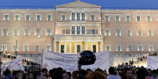 Greek riot police stand on the steps leading up to the parliament building in Athens, as leftist protesters hold an anti-EU demonstration in Athens on July 12, 2015.