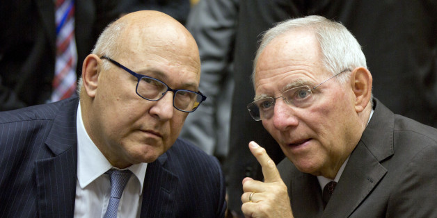 German Finance Minister Wolfgang Schaeuble, right, speaks with French Finance Minister Michel Sapin during a round table meeting of eurogroup finance ministers at the EU Lex building in Brussels on Sunday, July 12, 2015. Greece has another chance Sunday to convince skeptical European creditors that it can be trusted to enact wide-ranging economic reforms which would safeguard its future in the common euro currency. (AP Photo/Virginia Mayo)