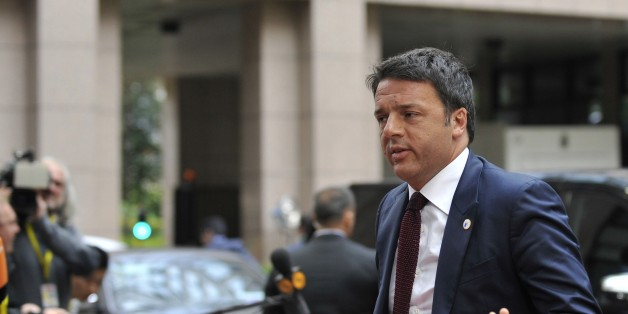 Italian Prime Minister Mateo Renzi arrives for a meeting in Brussels of the leaders of the 19 countries that use the euro currency, on July 12, 2015. The EU cancelled a full 28-nation summit today to decide whether Greece stays in the European single currency as a divided eurozone struggled to reach a reform-for-bailout deal.   AFP PHOTO / JEAN-CHRISTOPHE VERHAEGEN        (Photo credit should read JEAN-CHRISTOPHE VERHAEGEN/AFP/Getty Images)