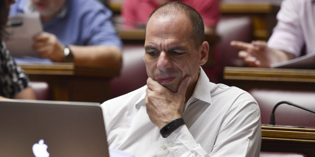 Former Greek Finance Minister Yianis Varoufakis reacts while reading a document on a laptop during a parliamentary group meeting at the Greek Parliament in Athens on July 10,  2015. Lawmakers in Greece are to vote whether to back a last-ditch reform plan the government submitted to creditors overnight in a bid to stave off financial collapse and exit from the eurozone.      AFP PHOTO / LOUISA GOULIAMAKI        (Photo credit should read LOUISA GOULIAMAKI/AFP/Getty Images)