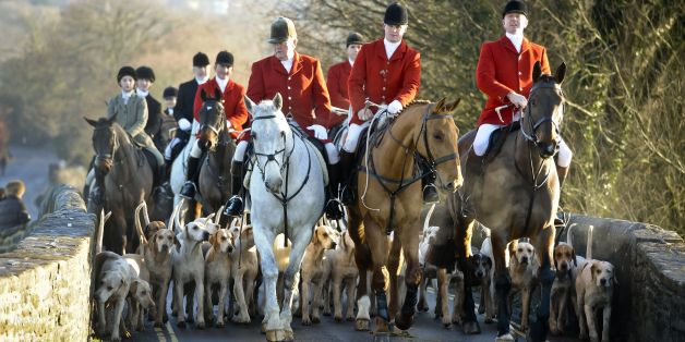 The Avon Vale hunt makes its way to the village of Laycock, Wiltshire on the traditional Boxing Day meet