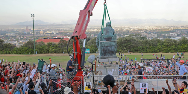 CAPE TOWN, SOUTH AFRICA  APRIL 9 (SOUTH AFRICA OUT): Students celebrate as the Cecil John Rhodes statue is removed at the University of Cape Town on April 9, 2015 in CapeTown, South Africa. After nearly a month of protesting, sit-ins and relentless meetings by students, the statue of British colonialist will finally be removed. (Photo by Nardus Engelbrecht/Gallo Images/Getty Images)