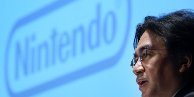 FILE PHOTO: Satoru Iwata, president of Nintendo Co., speaks during a news conference in Tokyo, Japan, on Thursday, Jan. 30, 2014. Iwata, who led the Japanese gamemaker back to ascendancy in the early 2000s with the Wii console, died July 11, 2015, from bile duct cancer, the Kyoto-based company said in a statement. Photographer: Tomohiro Ohsumi/Bloomberg via Getty Images
