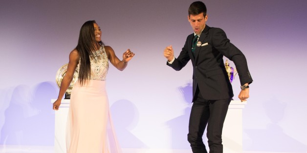 LONDON, ENGLAND - JULY 12:  (EDITORIAL USE ONLY - NO COMMERCIAL USEAGE)  Serena Williams of the United States and Novak Djokovic of Serbia dance on stage at the Champions Dinner at the Guild Hall on day thirteen of the Wimbledon Lawn Tennis Championships at the All England Lawn Tennis and Croquet Club on July 12, 2015 in London, England.  (Photo by Thomas Lovelock - AELTC Pool/Getty Images)