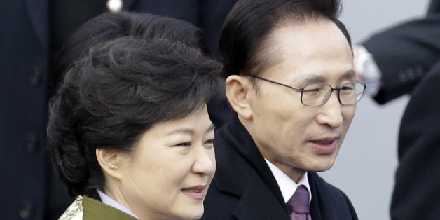 FILE - In this Feb. 25, 2013 file photo, South Korea's outgoing President Lee Myung-bak, right, walks with new President Park Geun-hye after Park's inauguration ceremony as the 18th South Korean president at the National Assembly in Seoul, South Korea. Late North Korean leader Kim Jong Il repeatedly pushed for summit talks with South Korea before his 2011 death but the plans failed because Pyongyang demanded $10 billion and large-scale shipments of food and fertilizer, Lee said in a memoir to be