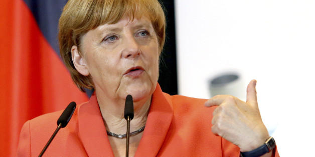 Visiting German Chancellor Angela Merkel speaks during a news conference after meeting with Albanian Prime Minister Edi Rama, on the first stop of the Balkan tour in Tirana Wednesday, July 8, 2015. Merkel has urged Albania to fulfill five categories presented by the European Union in December regarding its public administration and justice system ahead of launching full membership talks. Last year Albania was granted the candidate status. (AP Photo/Hektor Pustina)