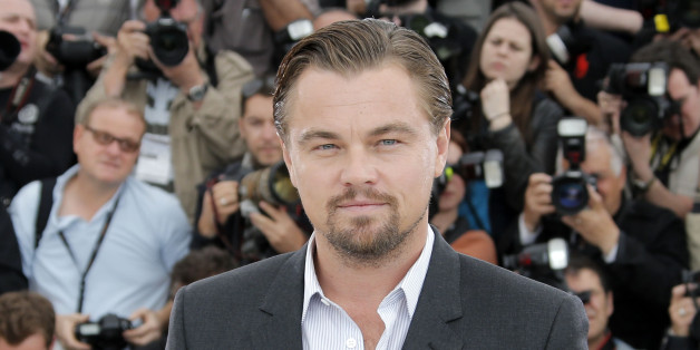 """FILE - This May 15, 2013 file photo shows actor Leonardo DiCaprio poses for photographers during a photo call for """"The Great Gatsby"""" at the 66th international film festival, in Cannes, southern France. Actor Leonardo DiCaprio bids on Chanel bags at the Heart Fund Gala in Cannes. (AP Photo/Francois Mori, File)"""