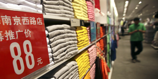A guest walks interior of the largest global flagship store of Uniqlo Thursday, May 13, 2010 in Shanghai, China. The UNIQLO Shanghai Global Flagship Store will open on May 15 officially. (AP Photo/Eugene Hoshiko)